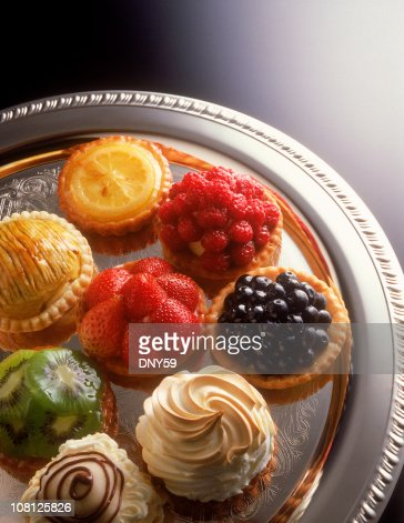 Fruit tarts on a silver serving tray