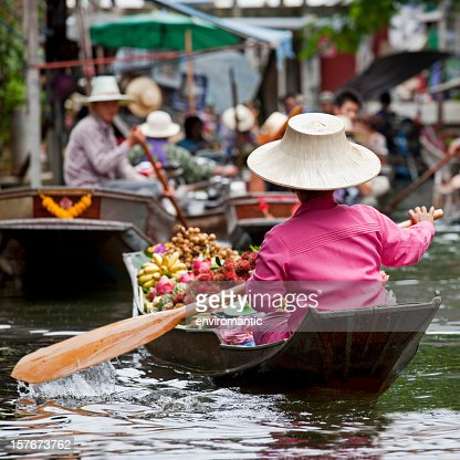 Fruit vendor at a floating market in Thailand