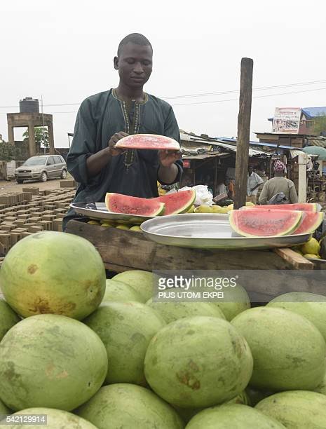 A fruit vendor displays water melon at Magboro market in southwest Nigeria Ogun State on June 21 2016 Ordinary Nigerians are feeling the full effects...