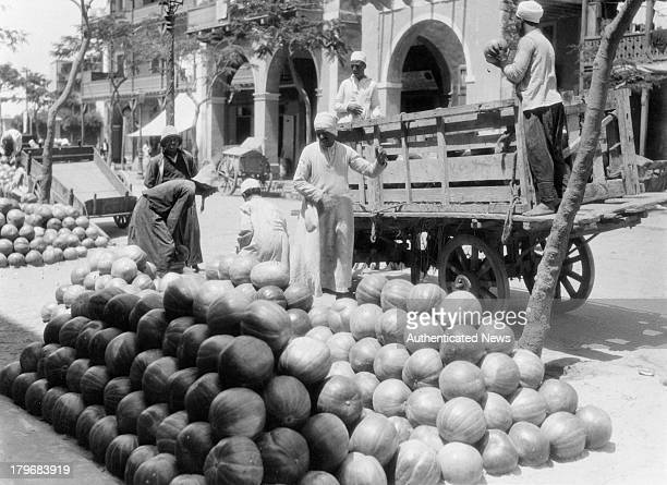 Fruit vendors sell winter melons in a market in Port Said Egypt