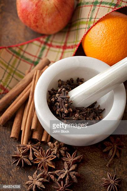Fruit with spices in pestle and mortar