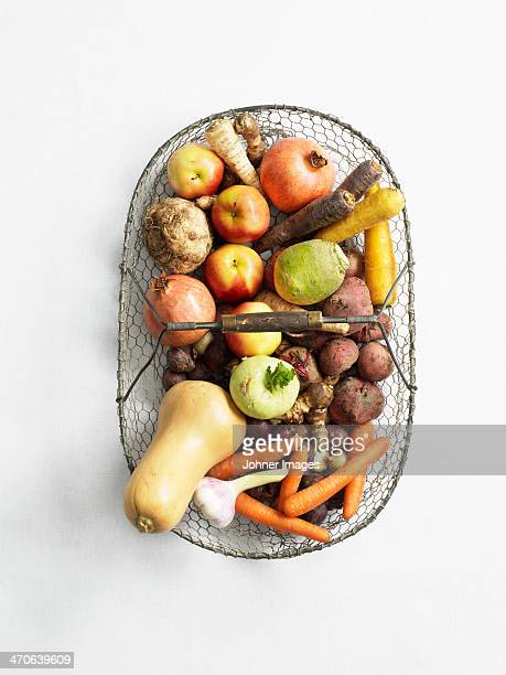 Fruits and vegetables in wire basket, directly above