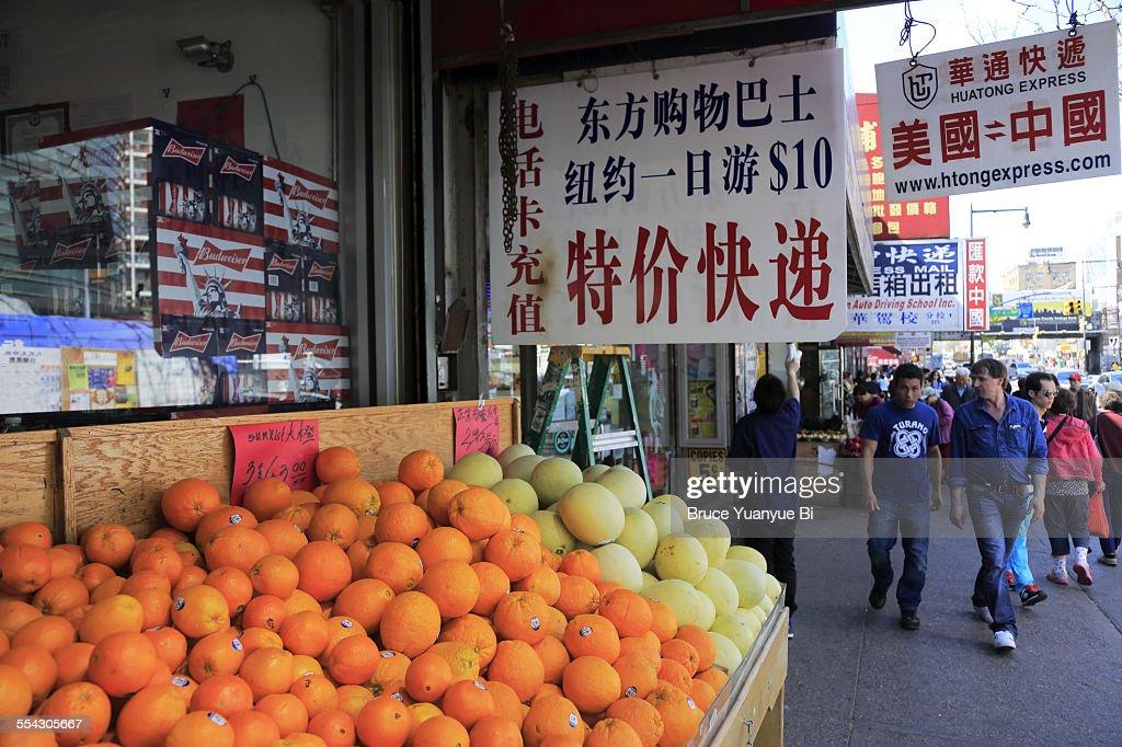 Fruits for sale on sidewalk stalls