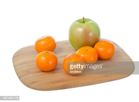 Fruits on cutting board. : Stock Photo