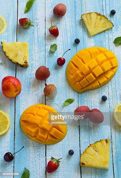 Fruits on light blue wooden background.