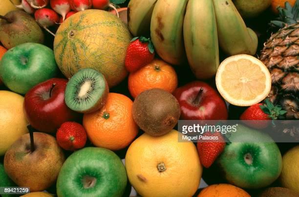 Oranges bananas kiwi pears apples strawberries pineapple and melon