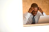 Frustrated African-american businessman.