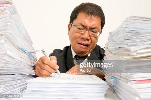 Frustrated at paperwork : Stock Photo