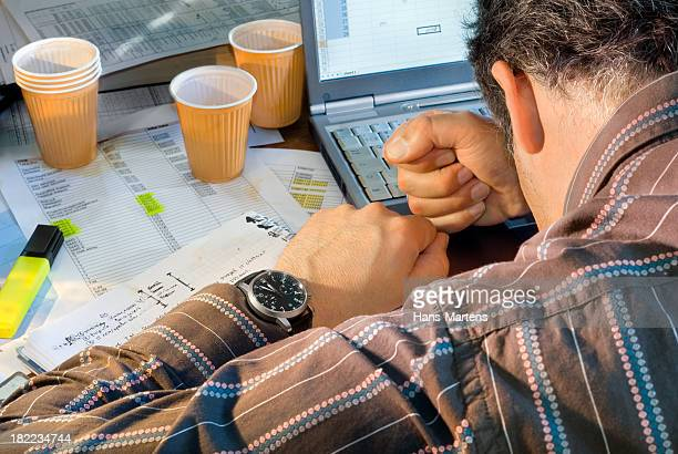 Frustrated business man trying to reach his deadline