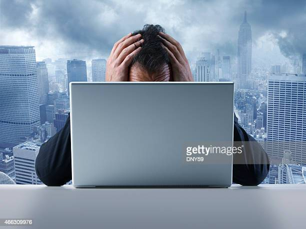 Frustrated businessman in front of laptop computer
