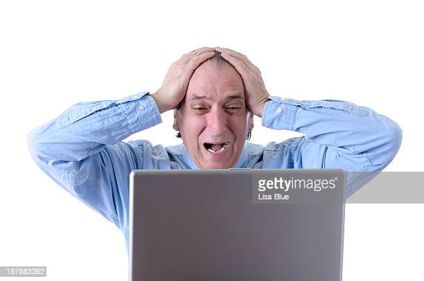 Frustrated Businessman with Head In Hands Looking PC