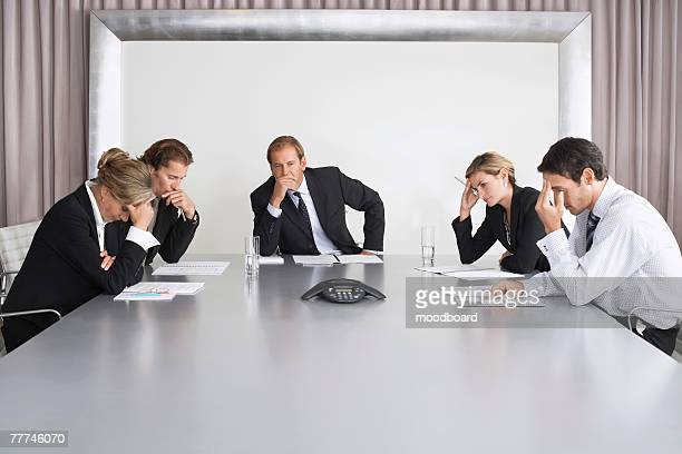 Frustrated Businesspeople Listening to Conference Call