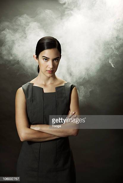 Frustrated businesswoman fuming with smoke