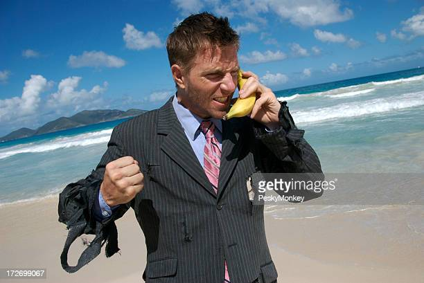 Frustrated Castaway Businessman Talks on Mobile Banana
