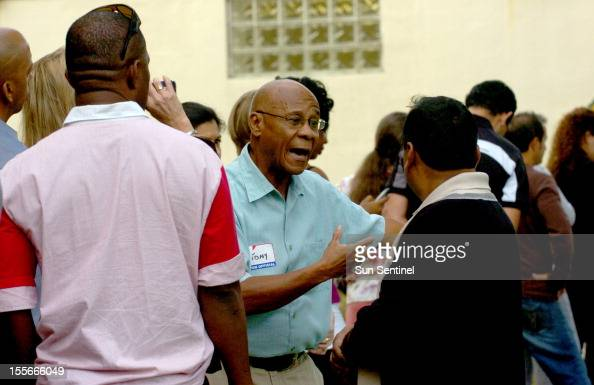 A frustrated election official named Tony center talks with voters waiting in line including Mohammad Azim Hossain from Davie telling them that the...