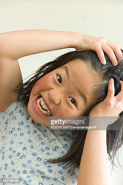 Frustrated girl with her hands on her head