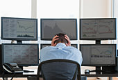 Frustrated male trader at work