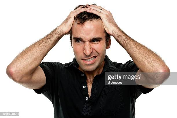 Frustrated Man With Hands In Hair