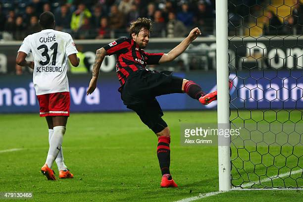 Frustrated Marco Russ of Frankfurt hits the goal post during the Bundesliga match between Eintracht Frankfurt and SC Freiburg at Commerzbank Arena on...