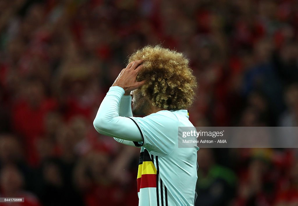 A frustrated <a gi-track='captionPersonalityLinkClicked' href=/galleries/search?phrase=Marouane+Fellaini&family=editorial&specificpeople=3936316 ng-click='$event.stopPropagation()'>Marouane Fellaini</a> of Belgium during the UEFA Euro 2016 quarter final match between Wales and Belgium at Stade Pierre-Mauroy on July 1, 2016 in Lille, France.
