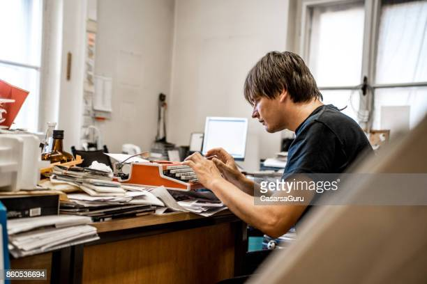 Frustrated Office Worker Using Typewriter