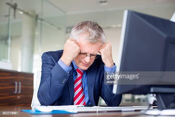 Frustrated senior business man