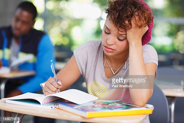 Frustrated student at work in classroom