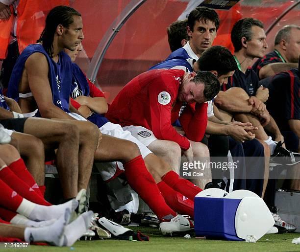 A frustrated Wayne Rooney of England sits on the bench after being substituted during the FIFA World Cup Germany 2006 Group B match between Sweden...