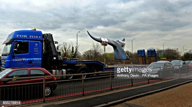 A 10 ft high 20 ft wide life size model of a Blue Whale tail commissioned by the National Geographic Channel tail is transported along the A40 near...