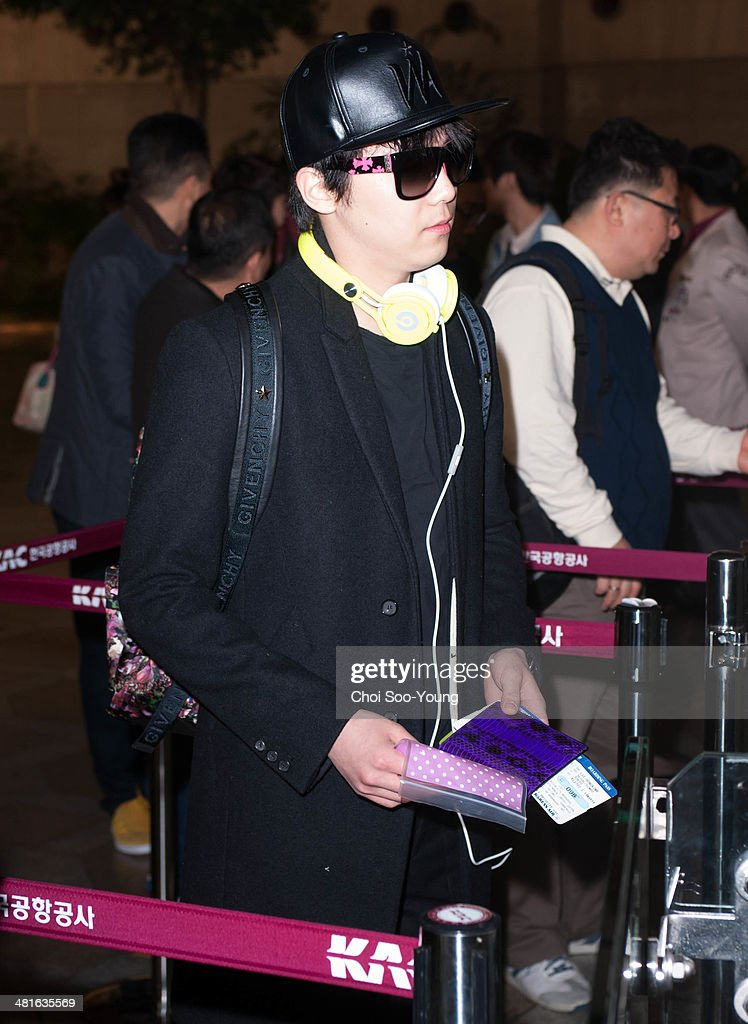 FTIsland is seen at Gimpo International Airport on March 14 2014 in Gimpo South Korea