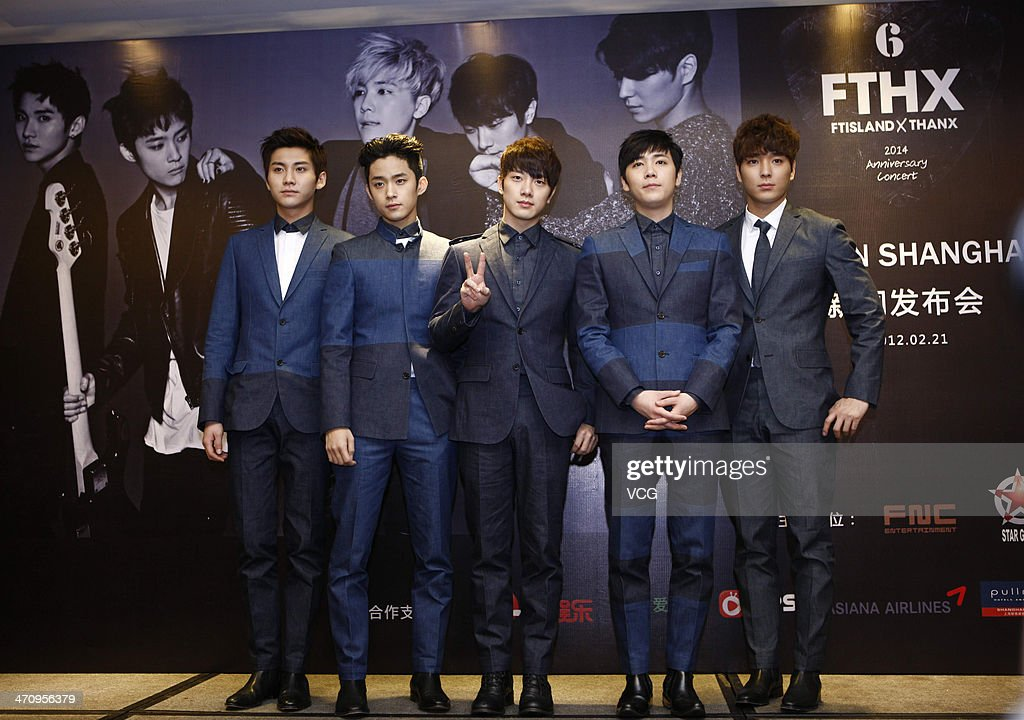 FTIsland pose for photographs at press conference on February 21 in Shanghai China