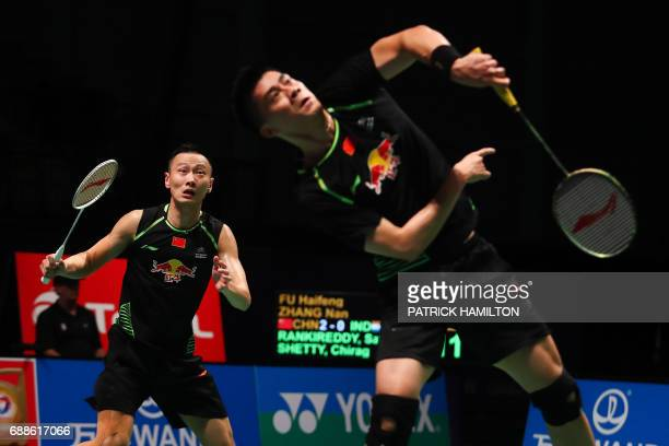 Fu Haifeng and partner Zhang Nan of China hit a return during their men's doubles Sudirman Cup badminton match against India's Satwiksairaj...