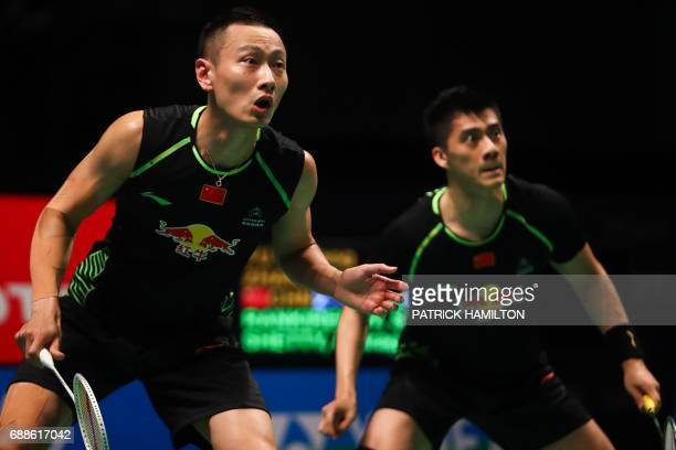 Fu Haifeng and partner Zhang Nan of China look across the net during their men's doubles Sudirman Cup badminton match against India's Satwiksairaj...