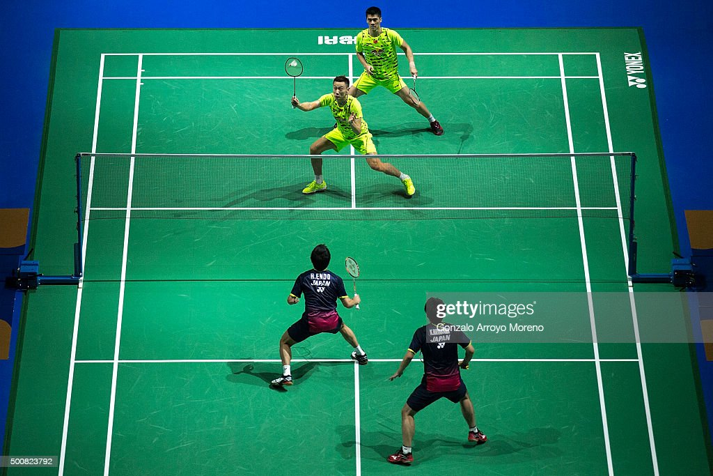 Fu Haifeng and <a gi-track='captionPersonalityLinkClicked' href=/galleries/search?phrase=Zhang+Nan+-+Badminton+Player&family=editorial&specificpeople=9612243 ng-click='$event.stopPropagation()'>Zhang Nan</a> of China in action in the Men's Doubles match against <a gi-track='captionPersonalityLinkClicked' href=/galleries/search?phrase=Hiroyuki+Endo&family=editorial&specificpeople=5530229 ng-click='$event.stopPropagation()'>Hiroyuki Endo</a> and <a gi-track='captionPersonalityLinkClicked' href=/galleries/search?phrase=Kenichi+Hayakawa&family=editorial&specificpeople=5851276 ng-click='$event.stopPropagation()'>Kenichi Hayakawa</a> of Japan during day two of the BWF Dubai World Superseries 2015 Finals at the Hamdan Sports Complex on December 10, 2015 in Dubai, United Arab Emirates.