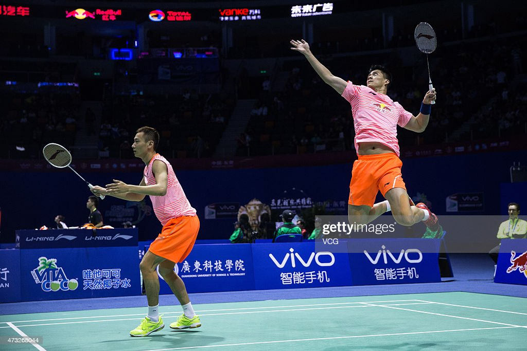 Fu Haifeng and <a gi-track='captionPersonalityLinkClicked' href=/galleries/search?phrase=Zhang+Nan+-+Badminton+Player&family=editorial&specificpeople=9612243 ng-click='$event.stopPropagation()'>Zhang Nan</a> of China return to Michael Fuchs and Peter Kaesbauer of Germany during Men's Doubles match on day five of 2015 Sudirman Cup BWF World Mixed Team Championships on May 14, 2015 in Dongguan, Guangdong province of China.