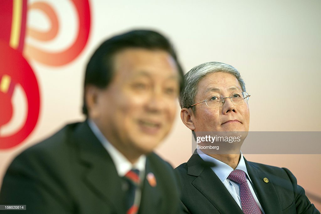 Fu Yuning, chairman of China Merchants Group Ltd., right, and Hu Zheng, vice president of China Merchants Group Ltd., listen to questions during a news conference in Hong Kong, China, on Tuesday, Dec. 18, 2012. China Merchants Group, an investment holding company, comprises of property management, transportation and financial investment businesses. Photographer: Jerome Favre/Bloomberg via Getty Images