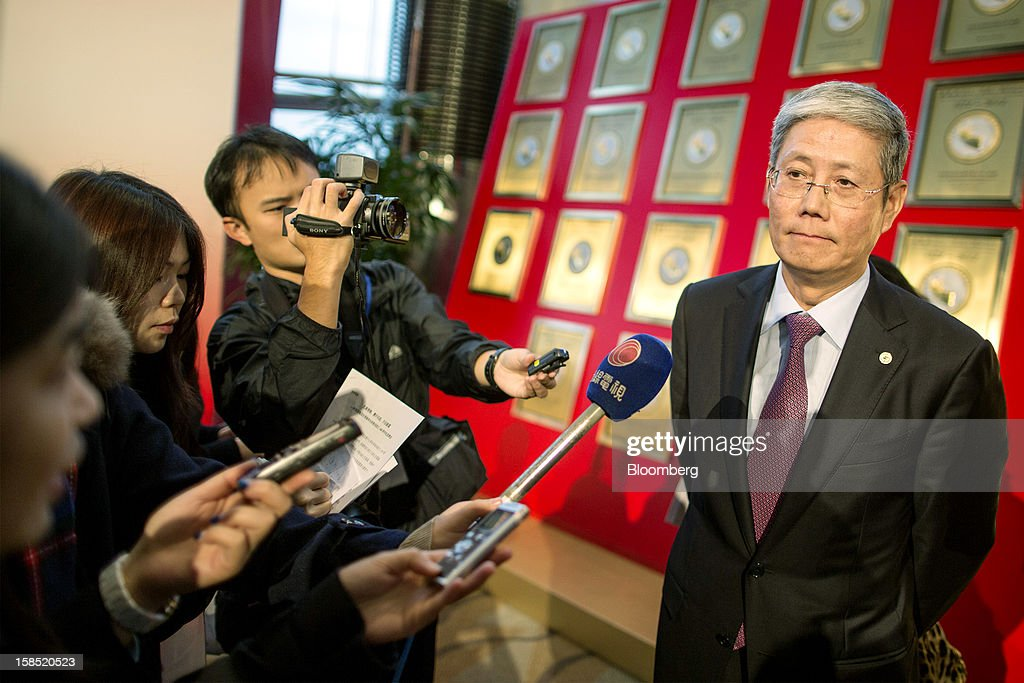 Fu Yuning, chairman of China Merchants Group Ltd., right, pauses as he speaks to the media following a news conference in Hong Kong, China, on Tuesday, Dec. 18, 2012. China Merchants Group, an investment holding company, comprises of property management, transportation and financial investment businesses. Photographer: Jerome Favre/Bloomberg via Getty Images