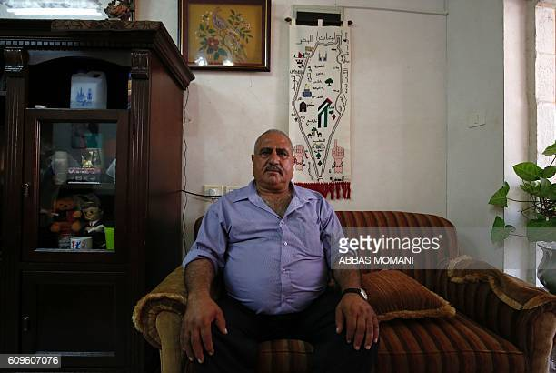 Fuad Maadi a 60yearold Palestinian man whose family says they own a piece of land that might be used to relocate houses from the nearby wildcat...