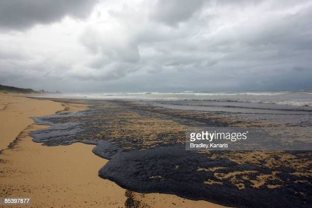 Fuel and ammonium nitrate is seen on Buddina Beach on the Sunshine Coast as a result of the oil slick which escaped from the container ship 'Pacific...