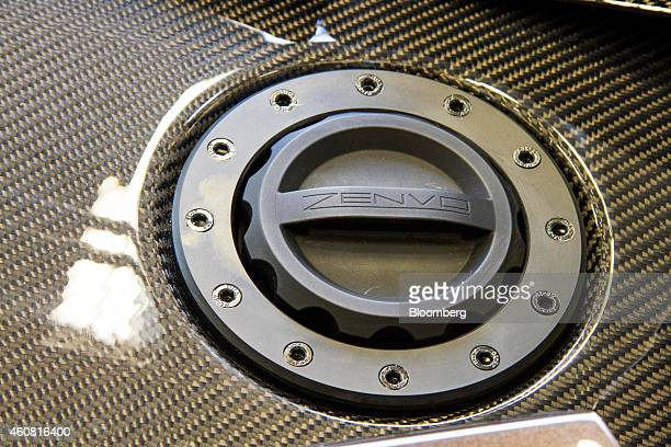 A fuel cap sits on the carbon fibre body panel of a Zenvo ST1 supercar used for auto show displays at the headquarters of Zenvo Automotive in...
