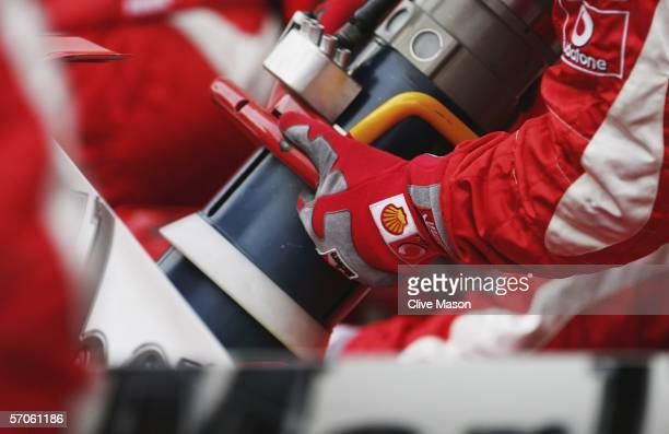 A fuel hose is seen as a Ferrari pit crew practice a pit stop practice after qualifying for the Bahrain Formula One Grand Prix at the Bahrain...