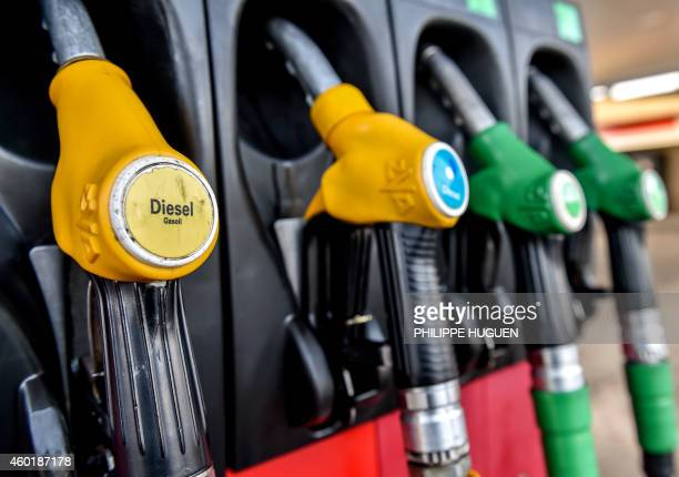 Fuel nozzles are seen at a gas station in Bailleul on December 9 2014 AFP PHOTO / PHILIPPE HUGUEN / AFP PHOTO / PHILIPPE HUGUEN
