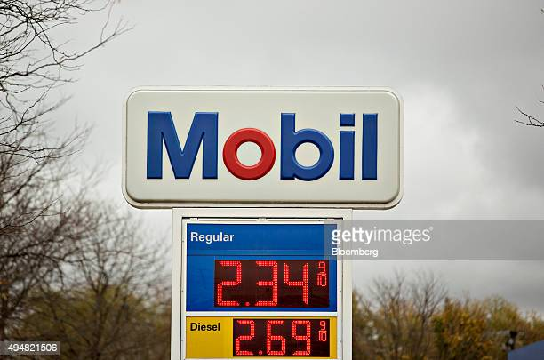 Fuel prices are displayed at an Exxon Mobil Corp gas station in Rockford Illinois US on Wednesday Oct 28 2015 Exxon Mobil Corp is scheduled to report...