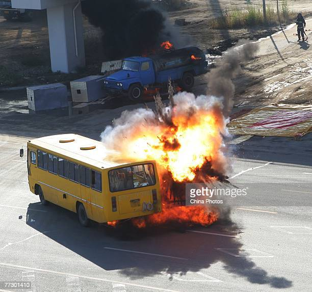 A fuel tanker explodes in a simulated crash with a coach during a public emergency drill held by emergency services at Yitonghe Metro Railway Station...