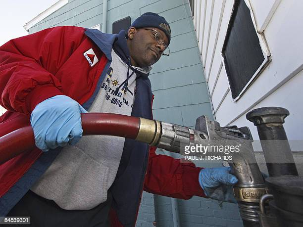 Fuel truck driver Charlie Brown pumps in heating oil for the first delivery of the year from the CITGOVenezuela heating oil program January 29 2009...