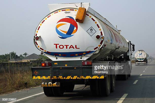 Fuel trucks branded with the Total SA logo pass along a road in Port Harcourt Nigeria on Friday Jan 15 2016 With his security forces engaged in...