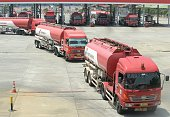 Fuel trucks queue to leave a Pertamina's filling center in Jakarta on August 27 2014 An official said in a press conference on August 27 that...