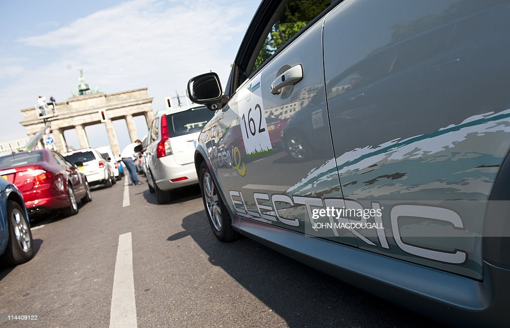 A fuelefficient car makes its way towards Berlin's Brandenburg Gate during a 'parade' of vehicles using alternative energy sources as part of the...