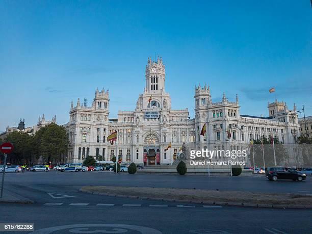 Fuente de Cibeles and palacio de Comunicaciones at sunset in Madrid Spain