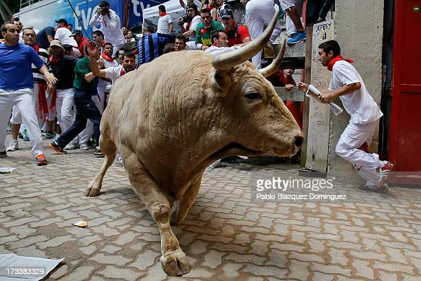 Fuente Ymbro's fighting bull enters the bullring during the eighth day of the San Fermin Running Of The Bulls festival on July 13 2013 in Pamplona...